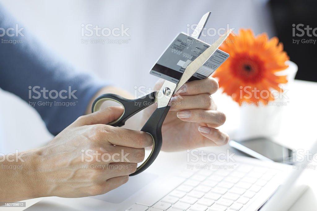 Scissors cutting a credit card stock photo