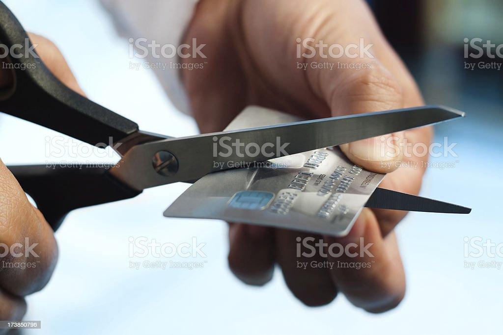 Scissors cutting credit card stock photo