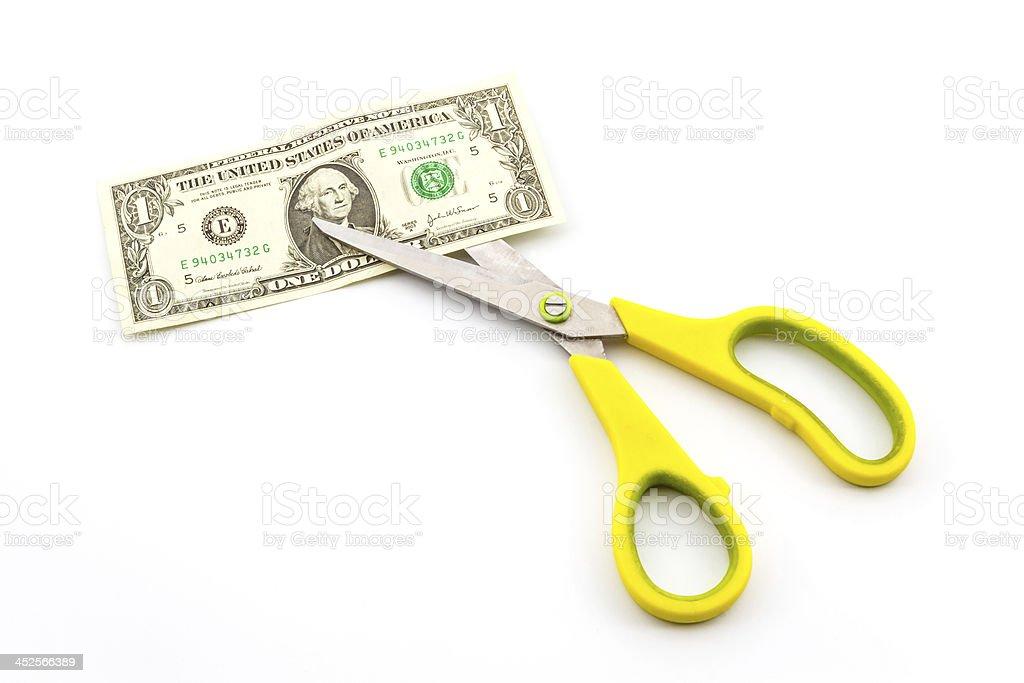 Scissors cutting dollar. stock photo
