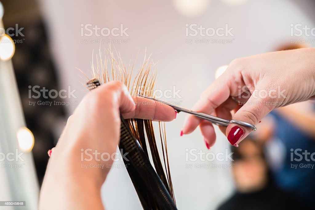 Scissors cutting hair stock photo