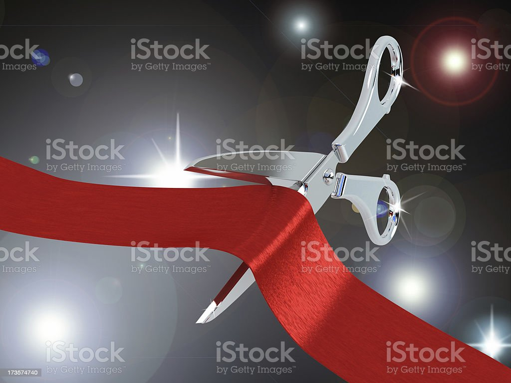 Scissors cutting red ribbon royalty-free stock photo