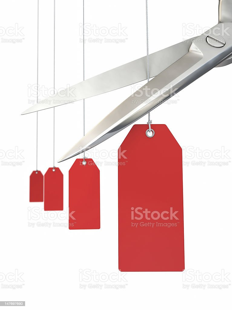Scissors cutting string on a price tag stock photo