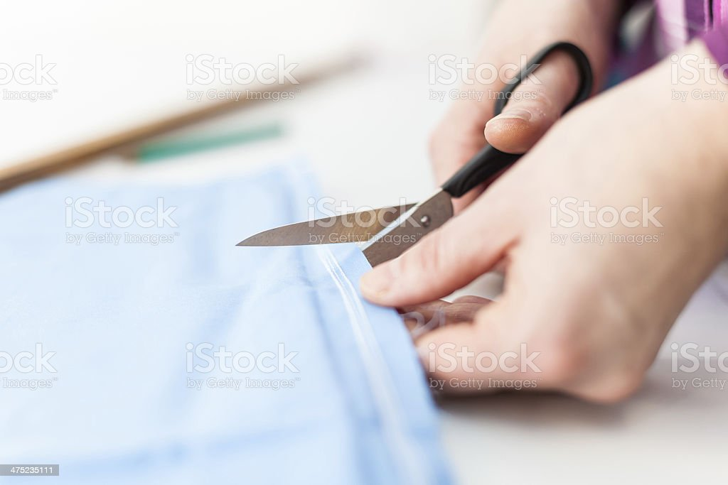 Scissors cutting tissue royalty-free stock photo