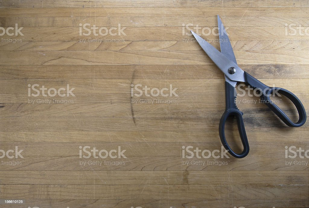 Scissors Sitting on Worn Butcher Block royalty-free stock photo