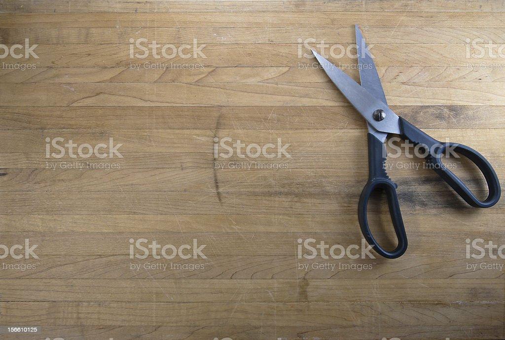 Scissors Sitting on Worn Butcher Block stock photo