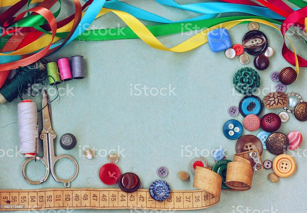 scissors, thread, needle, thimble, variety buttons, measuring ta stock photo