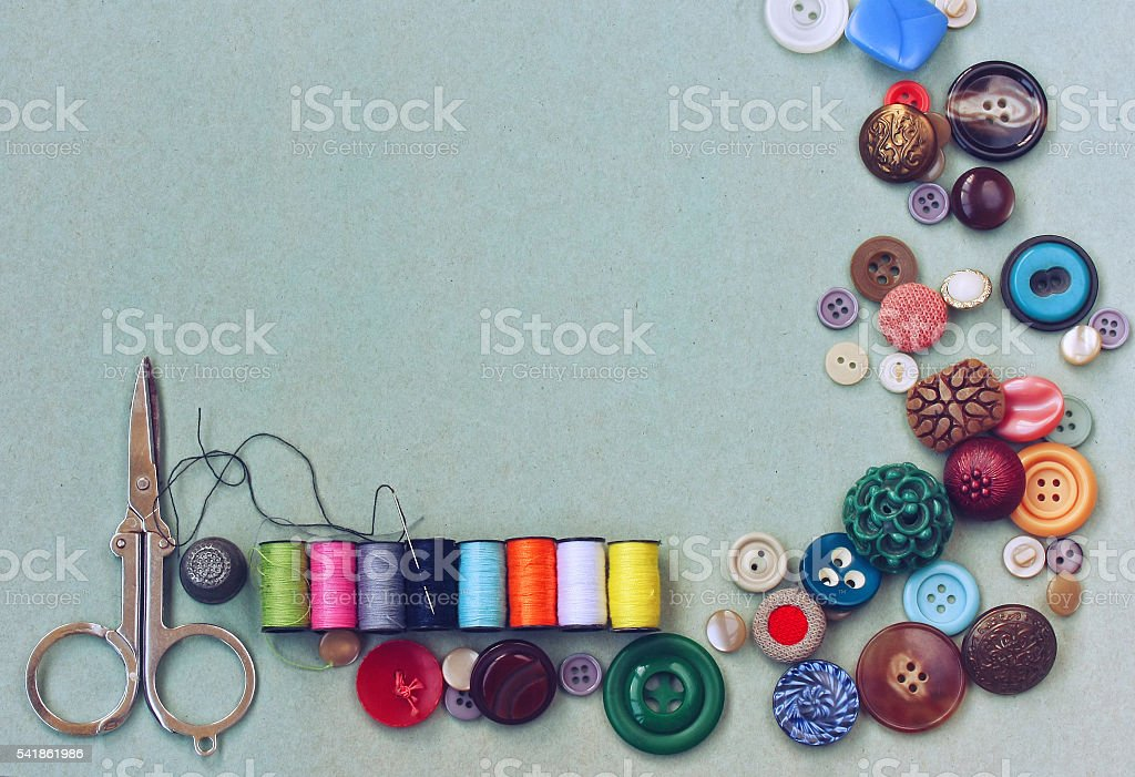 scissors, thread, needle, thimble, various buttons stock photo