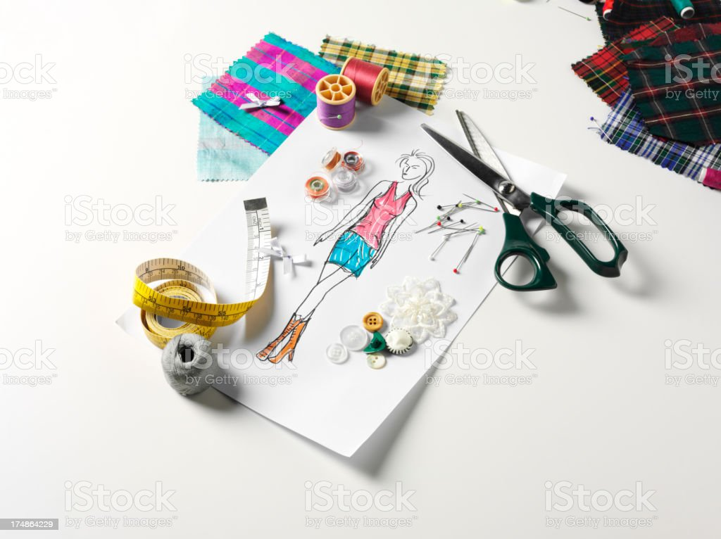 Scissors with a Fashion Sketch and Fabric Swatches royalty-free stock photo