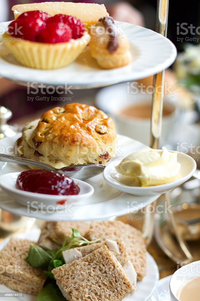 Scone, Jam and Clotted Cream, pastries, sandwiches for High Tea stock photo