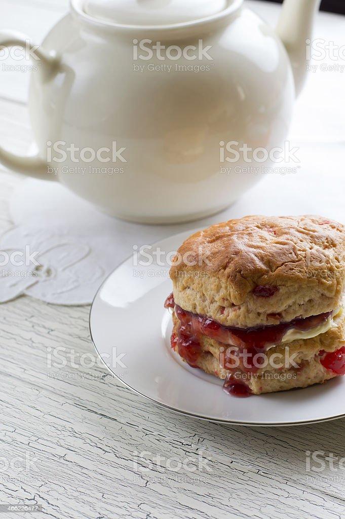 Scone with cream and jam stock photo