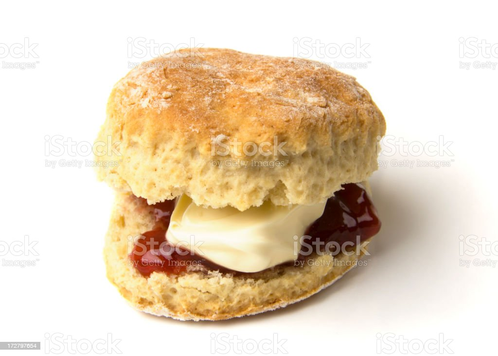 Scone with jam and clotted cream stock photo