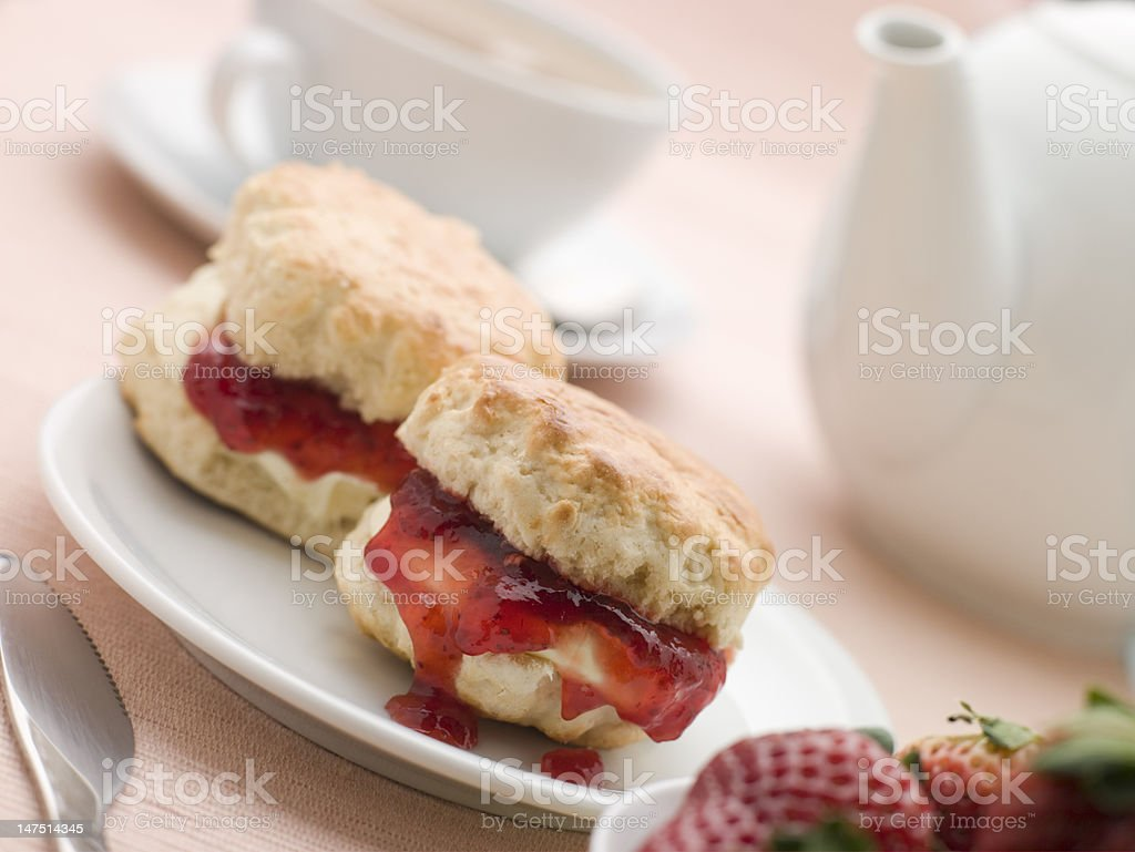 Scones Jam Clotted Cream and Strawberries with Afternoon Tea stock photo