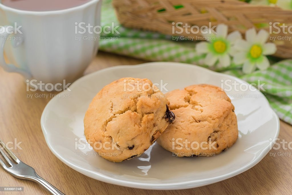 Scones on plate and cup of tea stock photo