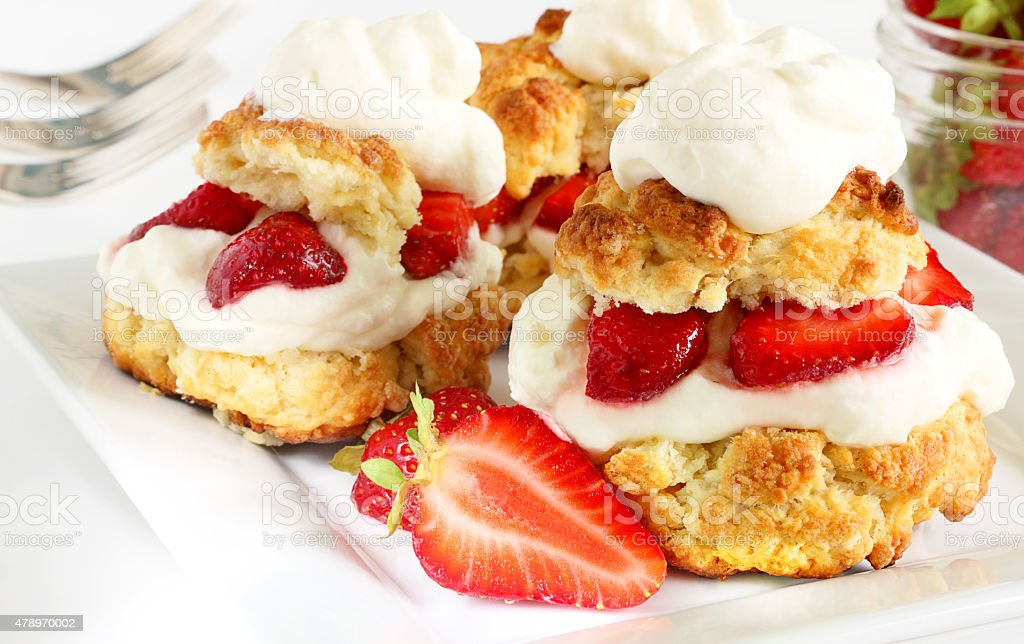 Scones, strawberries and cream stock photo