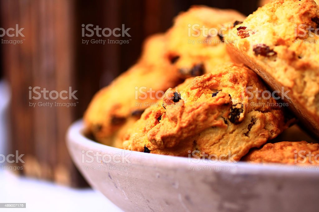 Scones with cranberries shot on a wooden background stock photo