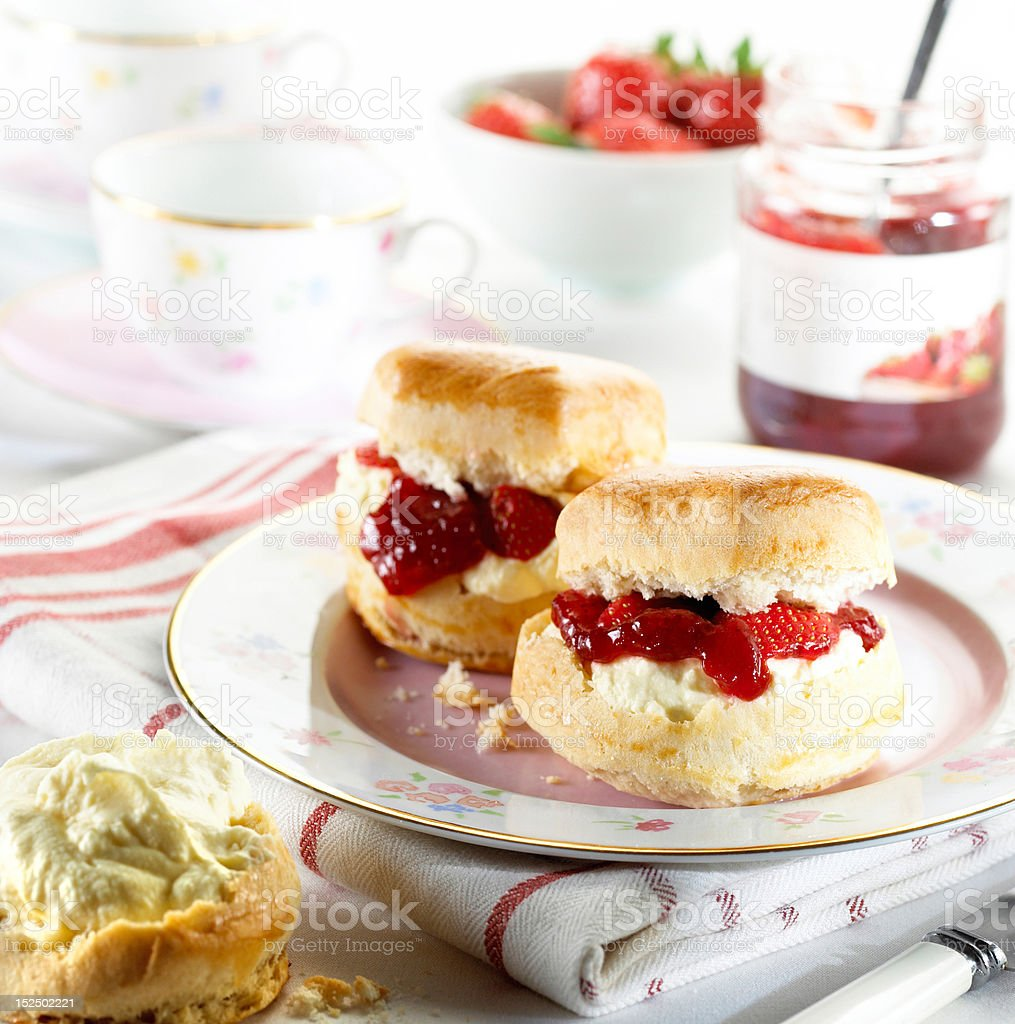 Scones with jam and cream stock photo