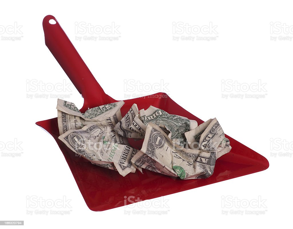 scoop and with dollars as waste stock photo