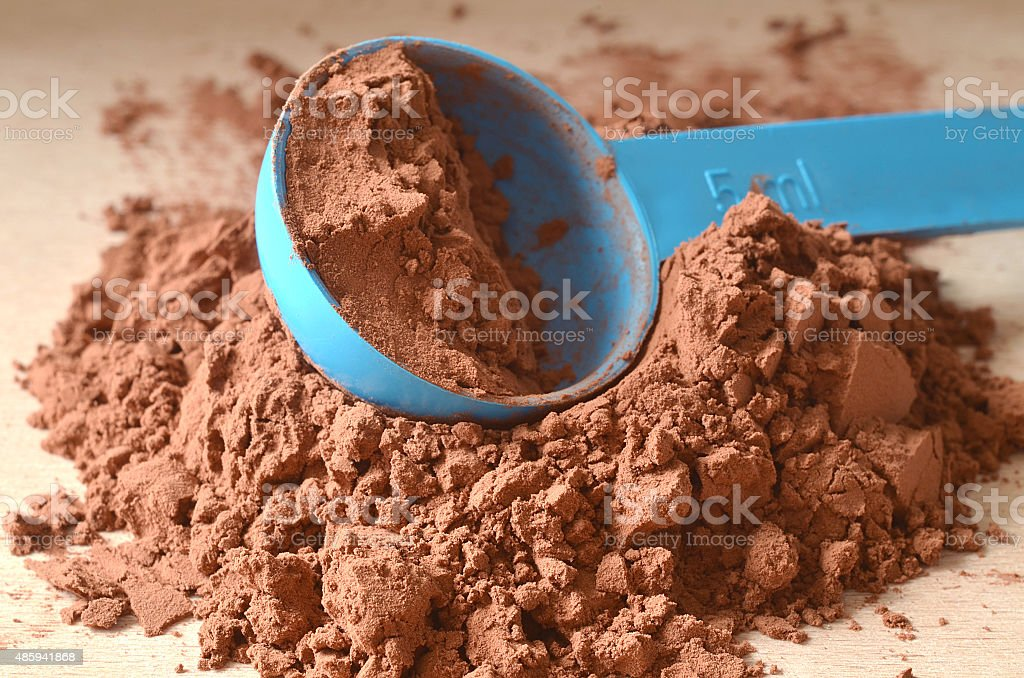 Scoop in brown powder stock photo