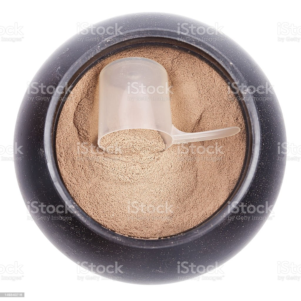 Scoop of chocolate whey isolate protein in black plastic containter stock photo