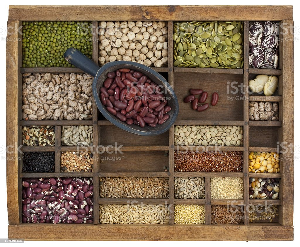scoop of red kidney beans and a grain, seeds variety stock photo