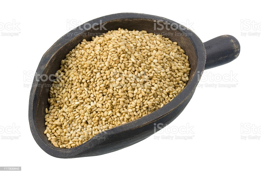 scoop of sesame seeds royalty-free stock photo