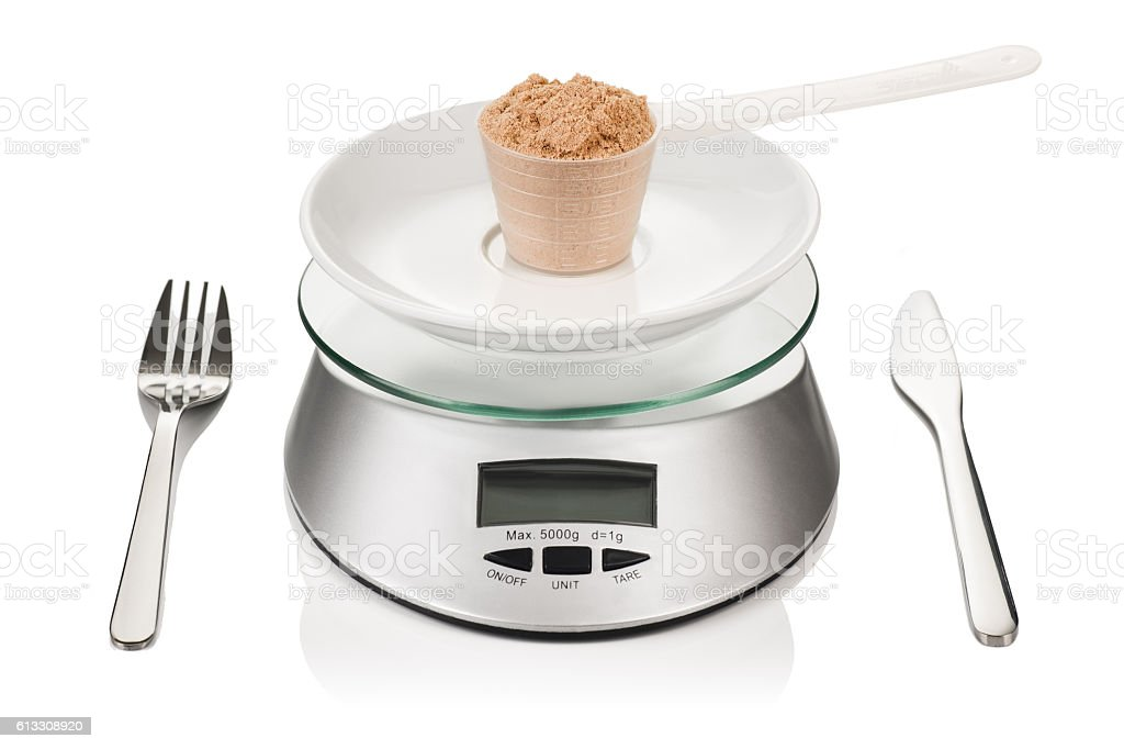 Scoop of whey protein isolated on kitchen weight. Sport diet stock photo