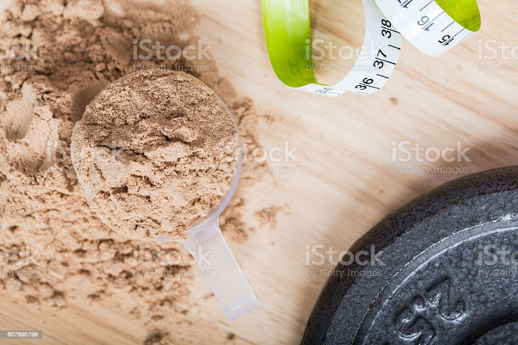 Scoop of whey protein with measure tape. stock photo