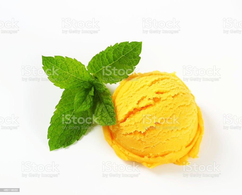 Scoop of yellow sorbet stock photo