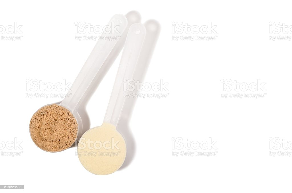 Scoop or spoon of whey protein isolated on white background stock photo