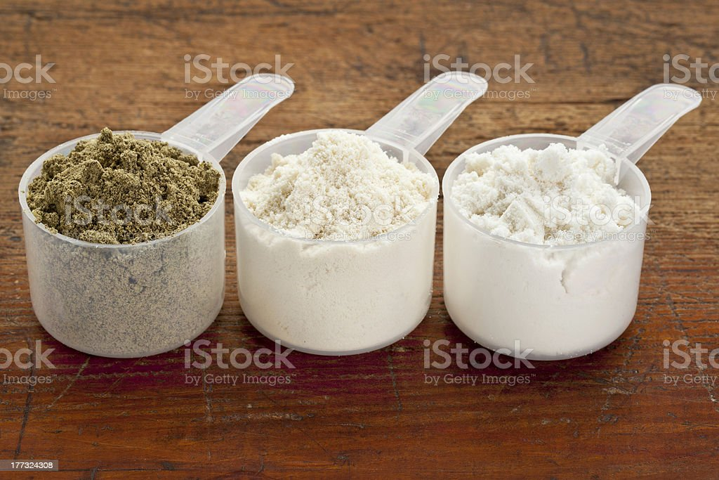 scoops of protein powder stock photo