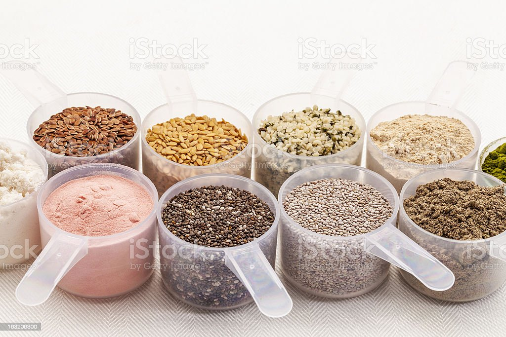 scoops of seeds and powders stock photo