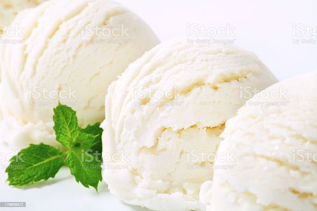Scoops of white ice cream with peppermint leaves stock photo