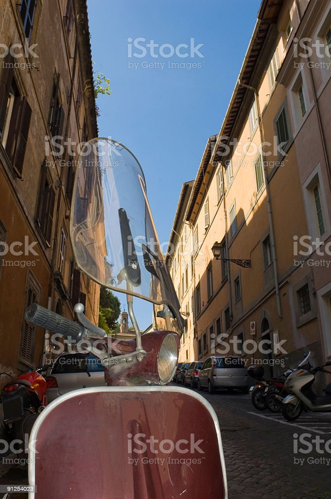 Scooter in narrow street, Rome royalty-free stock photo