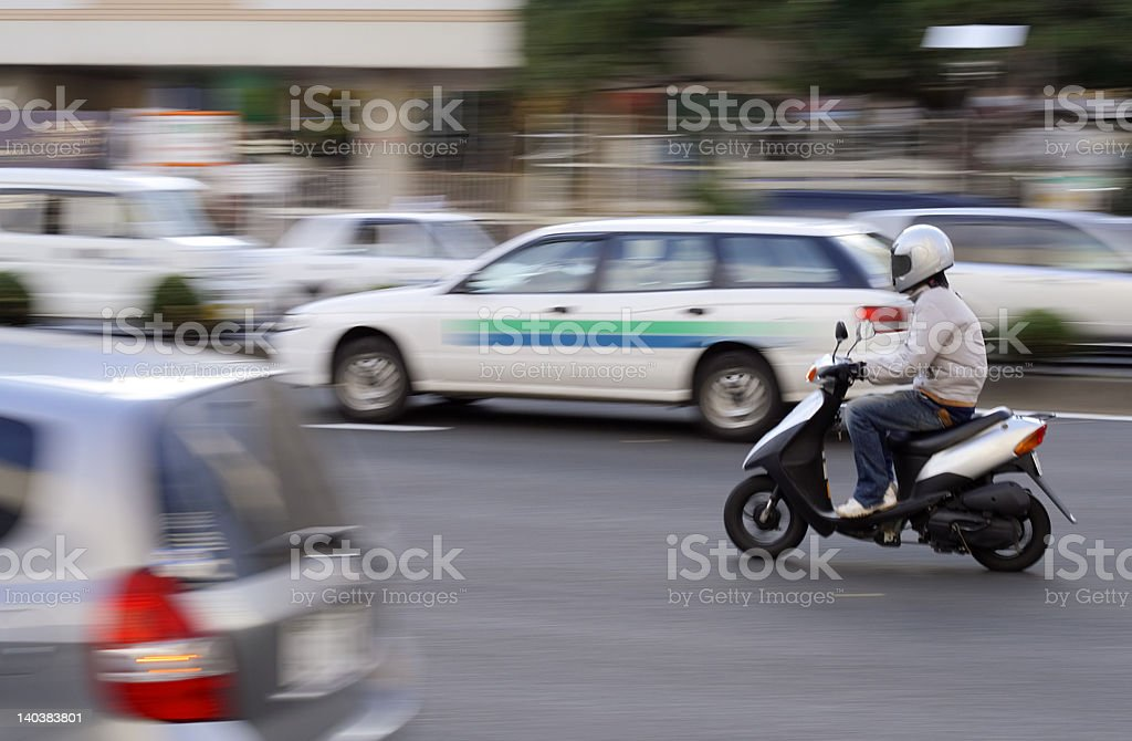 Scooter in traffic royalty-free stock photo