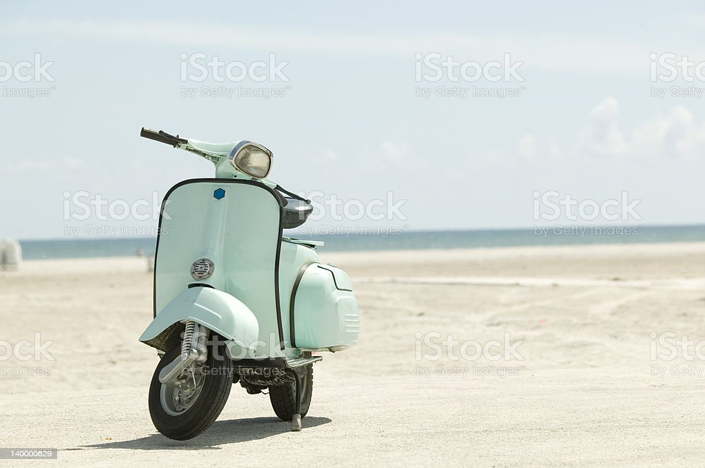 Scooter on the beach stock photo