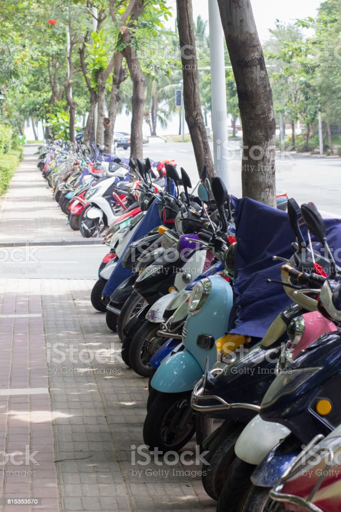 Scooter parking along the road in China stock photo