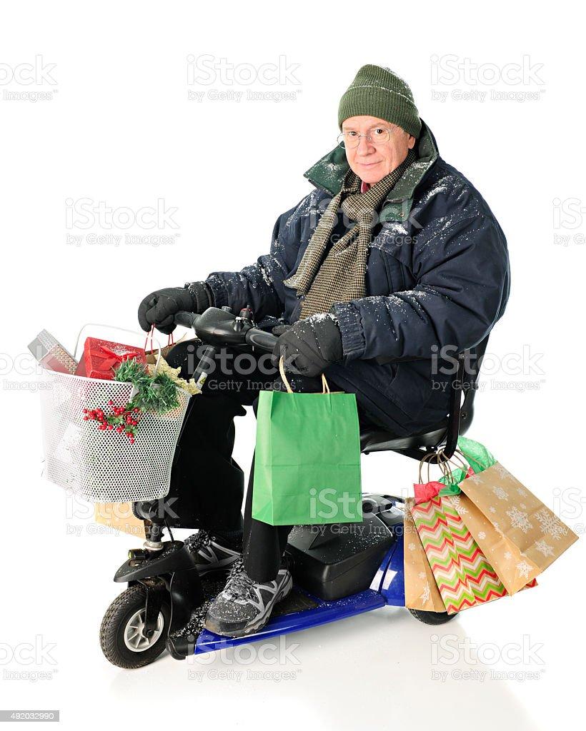 Scooter Riding Christmas Shopper stock photo