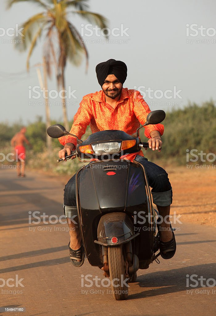 Scooter riding in Goa, India royalty-free stock photo