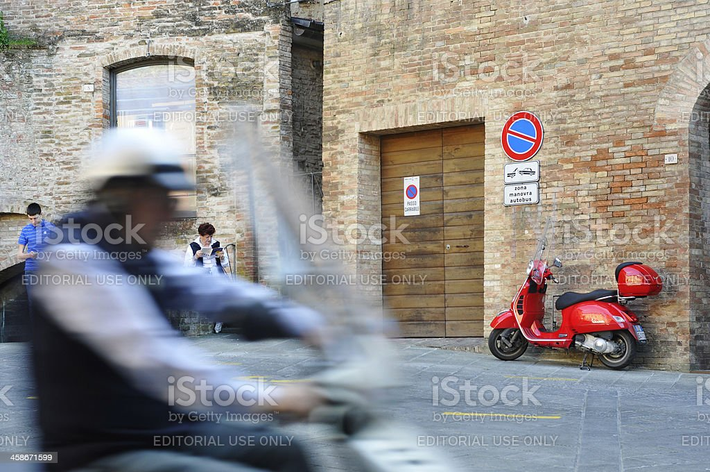 Scooters in the city center of Siena, Italy royalty-free stock photo