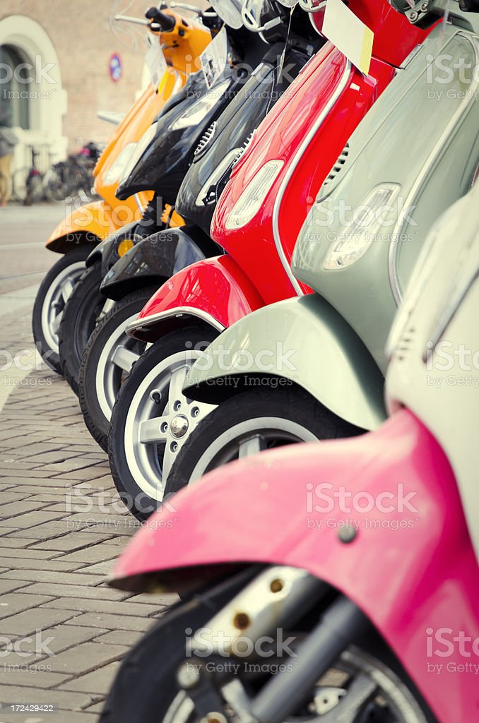 Scooters parked in a row royalty-free stock photo