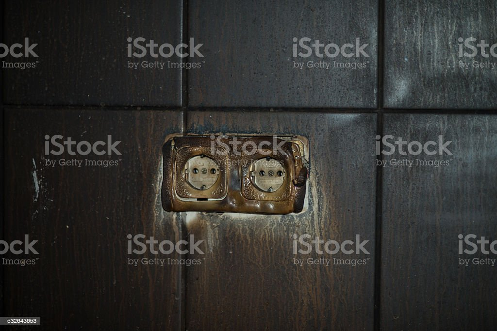 Scorched electrical outlet stock photo