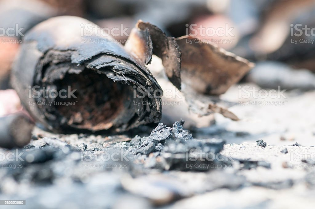 Scorched fireworks casing stock photo