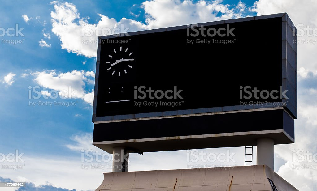scoreboard at football stadium with sky stock photo