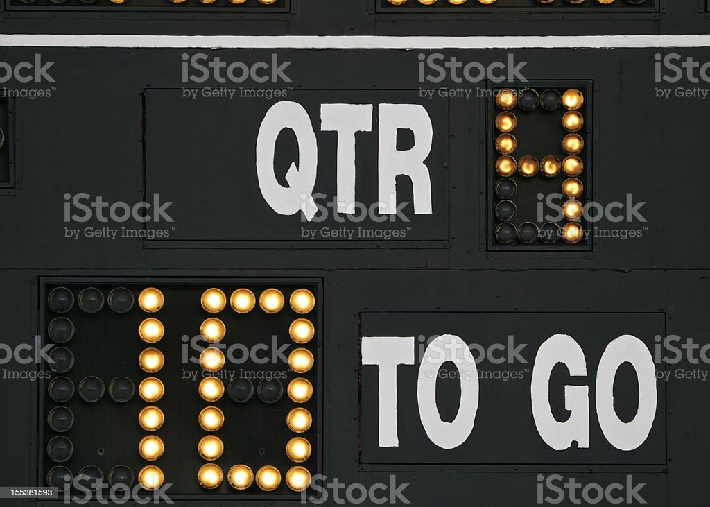 Scoreboard on American Football field yards to go and QTR stock photo
