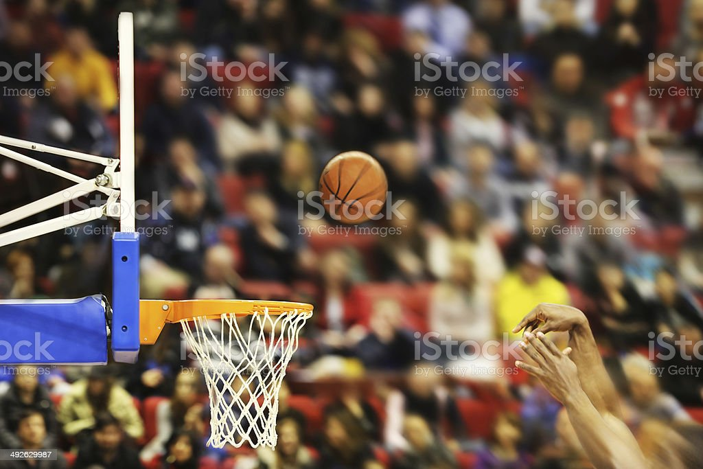 Scoring the winning points at a basketball game stock photo