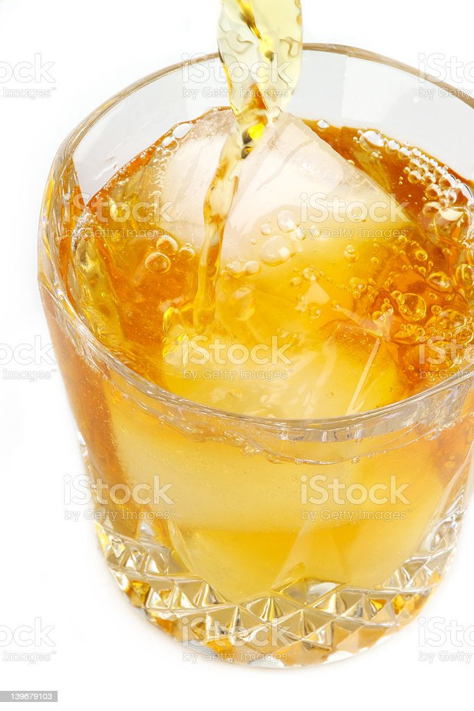 Scotch on the rocks being poured royalty-free stock photo