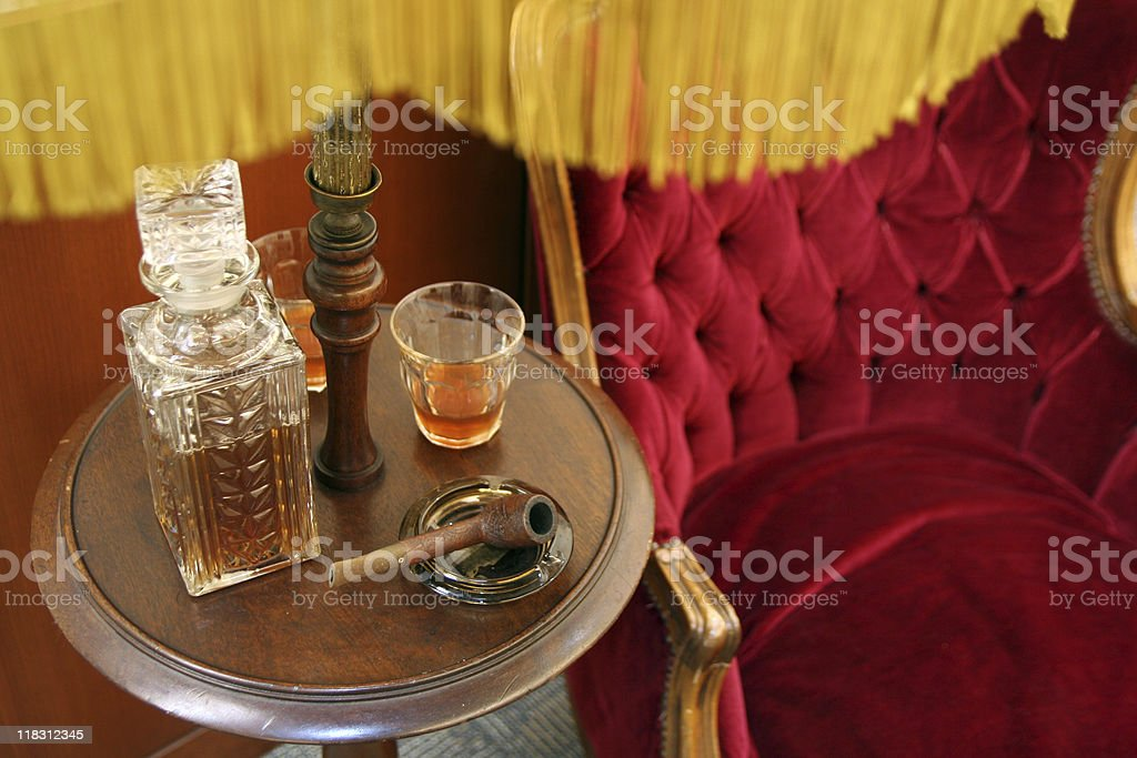 Scotch, Pipe, and velvet chair royalty-free stock photo