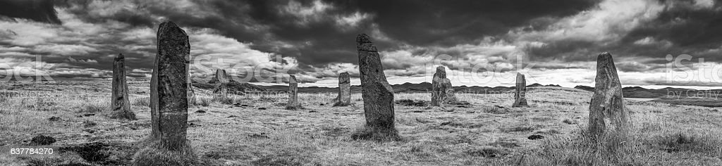 Scotland ancient standing stone circle Callenish Outer Hebrides monochrome panorama stock photo