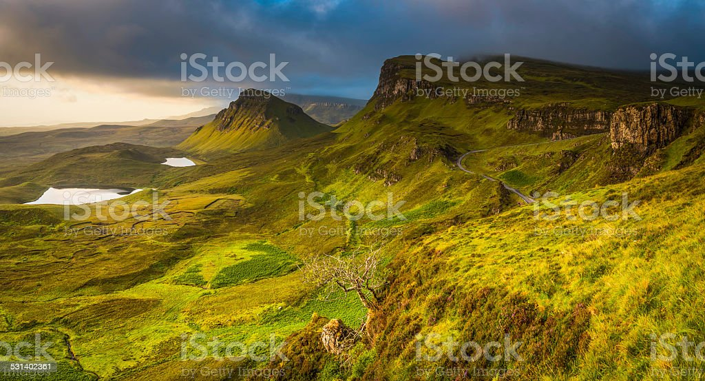 Scotland dramatic skies over Highland mountain peaks panorama Quiraing Skye stock photo