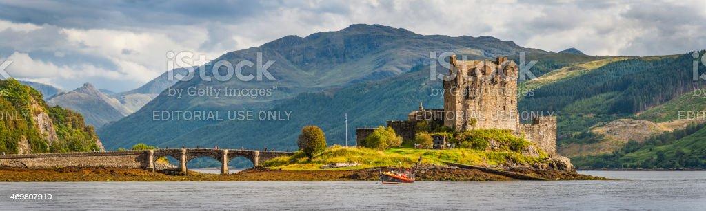 Scotland Eilean Donan Castle iconic Highlands mountain glen loch panorama stock photo